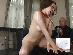 What a good kitty, but she still needs to be kept her in leash because we don't want to let her run away don't we? She's horny and now we repay her with some milk, pouring it on the floor and letting her lick it like a pussy that she is. Maybe she wants to lick some cock and sperm too.